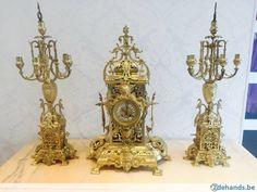 Antieke klok met 2 kandelaars
