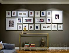 Candice Olson included this family photo wall in the living room to showcase some of the family's favorite memories. Wall Collage, Frames On Wall, White Frames, Hanging Frames, Wall Art, Photowall Ideas, Large Picture Frames, Photo Arrangement, Family Wall