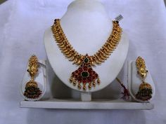 Sharada silver shop :	Silver Necklace with gold polish.