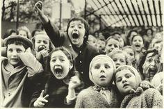 Kids watching a live puppet show.