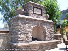 Like big arch and even if we did gas ... like the chimney look rising up.  Could do quatrefoil on chimney instead of field of tile...