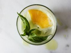 Kale Pineapple Basil Smash: http://www.seriouseats.com/recipes/2013/06/kale-pineapple-rye-whiskey-smash-cocktail-recipe.html