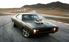a personal favorite. 1970 Dodge Charger. with a Chevy small-block V8 crate.