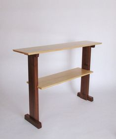 This narrow console table with shelf is an artistic choice for your sofa table. The shelf provides a space for displaying art, photos or even a small library collection. The taller table height lets you see some of the table above the sofa so you can enjoy the elegant design from a variety of views. This sofa table is a lovely way to define space and divide a room.  -The shelf is hand-cut into the legs for an interesting joinery detail. -The feet add stability to the narrow table -The velvet…