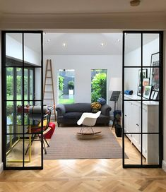 In theory, an open plan space sounds great. But, often it is not practical, especially in smaller flats. That's where glass wall partitions are brilliant, they help divide up a space and improve the acoustics - without compromising on light. The design below by Jenny Fields is a perfect example of how steel window partitions can help utilise a space.