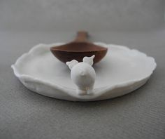 Spoon rest in white porcelain with a pig byTwoTreesWorld on Etsy  www.two-trees.eu