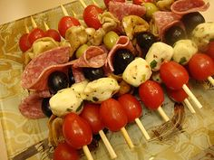 Party food! Antipasto Kebabs   This recipe makes a TON. Next time get 1/4lb pepperoni and salami, 1 12oz container mozz, 1/2 the amount of vinaigrette. Toss tomas with pasta in the vinaig.