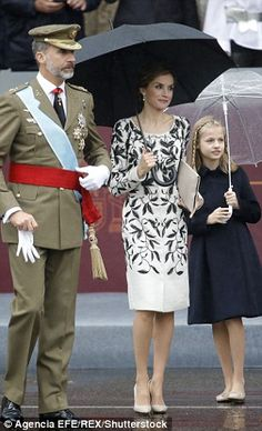 Prince charming: Letizia's dashing husband Felipe, 48, wore a full naval uniform including...