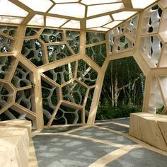 British architects NEX have designed this cubed timber pavilion for the Chelsea Flower Show in London with the same structural form as a leaf.    Eureka Pavilion by NEX    Between the gaps in the timber capillaries are smaller framework elements made from recycled plastic, curved to resemble leaf cells.