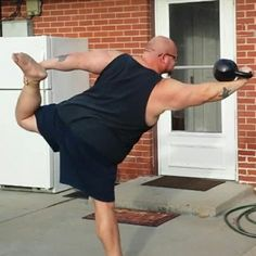 Very hard front kettlebell hold in bow and arrow yoga pose!