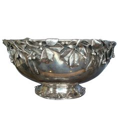 Amazing piece of art silver. This sterling silver Whiting punch bowl is decorated with applied 3-D holly with berries and 3-D mistletoe. These are cast and very realistic. It has a custom order #6692 by Whiting and dates to the 1880s.