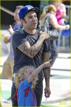 Pete Wentz takes his son Bronx to the Farmers Market carnival on October 14, 2012