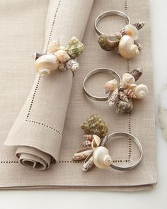 You can always dress up a plain napkin with a cute napkin ring! Shiraleah Sea Shell Napkin Rings, Set of 4 Napkin rings made of sea shells and stainless steel. each, x Imported. Tablecloths, Table Runners & Cocktail Napkins at Neiman Marcus Horchow Fine T Seashell Crafts, Beach Crafts, Diy And Crafts, Arts And Crafts, Diy Rings, Diy Napkin Rings, Wedding Napkin Rings, Beaded Napkin Rings, Napkin Folding