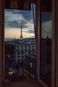 A moody, dreamy view of Paris and the Eiffel Tower.