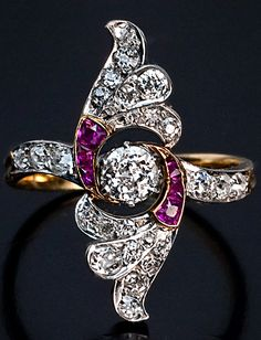 An Art Deco Diamond and Ruby Vintage Wing Ring Moscow, circa 1930 This finely crafted elegant Art Deco platinum and gold ring is designed as a pair of vert