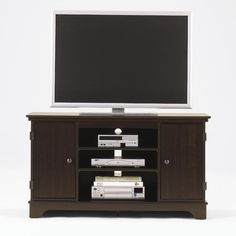 This media console with two doors is a perfect spot for your widescreen TV and media components. The three open compartments with wire management opening in the back are well-suited for a DVD player, cable box, and more. Two side doors offer concealed storage within for organizing media, such as DVDs, CDs, and books. Use this great TV console in your bedroom, living room, or family room.