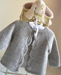 Aida top down Cardigan - Knitting pattern by OGE Knitwear Designs A classic design, simple leaf pattern adorns the front borders, knit in one piece seamlessly from the top down. Cardigan Bebe, Cardigan Pattern, Summer Cardigan, Knitted Baby Cardigan, Wool Cardigan, Knitting For Kids, Free Knitting, Knitting Sweaters, Simple Knitting