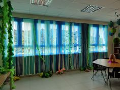 Curtains made from strips of plastic table cloth. Sea weed is spray painted paper cups strung together