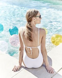 MAY '15 Style Guide: J.Crew women's V-neck tie one-piece swimsuit in white.