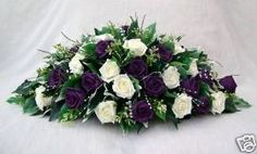 TOP TABLE ARRANGEMENT IN IVORY AND PURPLE ROSES WEDDING FLOWERS
