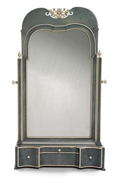 A Queen Anne style ivory and shagreen dressing mirror circa 1920 the arched mirror plate within a concave molding surmounted by a double-arched cresting rail centered by a pierced ivory coronet swiveling between two stiles surmounted by urn finials above a case centered by a small drawer fitted for manicure instruments above a deep drawer and flanked by deep drawers raised on bracket feet;  the reverse with an ivorine label stamped ASPREY / LONDON.