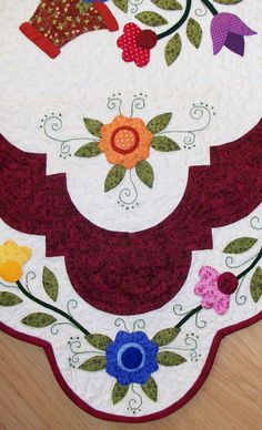 Like the contoured edges and floral vine around this applique quilt.