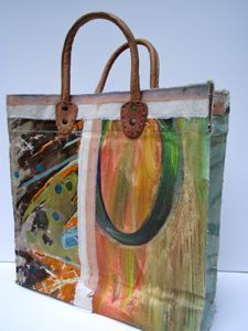A series of unique, leather handled carry bags made by hand using vintage oil paintings sourced exclusively from markets in Holland and Belgium. Each bag tells its own story through the juxtaposition of timeworn painted canvases, making each one a distinctive piece of functional, wearable art.