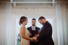 BRIK Venue | Real Wedding | Fort Worth | Texas | Industrial | Warehouse | Fawn & Fellow Photography | MOSS Floral Design | Ceremony | Bride | Groom | Husband | Wife | Bridal Bouquet | Wedding Dress | Blue Suit | Wood Floors | Wood Benches | Chandeliers | Draping | First Kiss | Mantle | Brass Candlesticks | Vintage Rugs