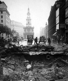 London Blitz: giant bomb crater in the Strand, 1940.