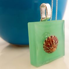 Green & red shell raised resin necklace Resin Necklace, Shells, Christmas Ornaments, Holiday Decor, Green, Shop, Shelled, Xmas Ornaments, Sea Shells