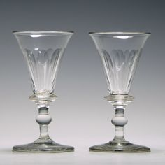 Heading : Pair of 19th century port wine glasses Date : c1810 Period : George III Origin : England Colour : Clear Bowl : A lipped conical bowl with slice cutting Stem : Annulated shoulder knop and a ball knop Foot : Conical Pontil : Polished Glass Type : Lead Size : 11.7cm tall with a 6.1cm bowl and a 6cm foot Condition : Excellent, no chips or cracks Restoration : None Weight : 223 grams Port Wine Glasses, French Wine, Wines, 19th Century, Restoration, Chips, Antiques, Architecture Sketches, Nice Asses