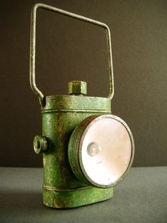 Vintage Bicycle Lamp with handle. British 1940's. Green. Industrial, shabby, distressed. £17.50, via Etsy.