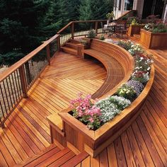 GORGEOUS DECK! Love the semi-circle seating and flower beds!!