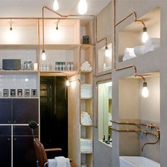 vintage bulbs on copper pipes - alcove lighting  from A Close Shave: A Cutting-Edge Barber Shop in Amsterdam : Remodelista