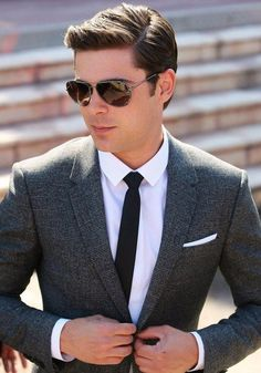 Zac Efron pulls off this look perfectly. It's smart enough for the office but the addition of a pocket square and sunglasses add a hint of style and individuality to the look.
