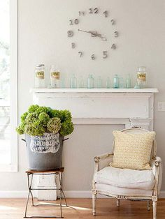 On Time.  Love this whole idea.  Old mantel behind furniture and old house letters used for a clock!