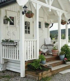 Rustic style wood steps with flower boxes on either side.