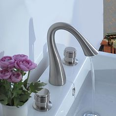 Contemporary Nickel Three Holes Two Handles Waterfall Bathroom Sink Faucet http://www.tapso.co.uk/contemporary-nickel-three-holes-two-handles-waterfall-bathroom-sink-faucet-p-543.html