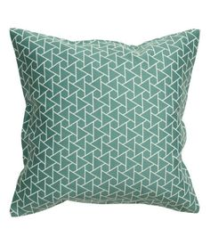 Geometric shapes play off the shapes in lumbar pillow but need to reverse the proportion of white vs. turquoise -- Jacquard-weave cushion cover with a concealed zip.