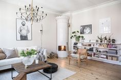 Scandinavian living room with shelves and a kakelugn