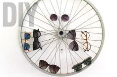DIY sunglasses display. http://blog.swell.com/DIY-Sunglass-Bike-Wheel-Display