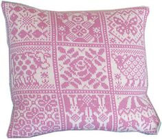 The pillow is knitted in the round and steeked.