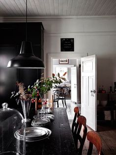 A black and white Scandinavian country kitchen in where old meets new