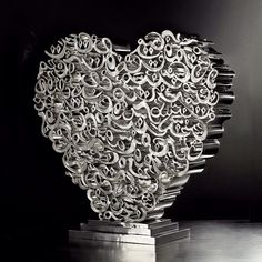 """""""Love"""" from the Invisible light Art exhibition. Made from polished stainless steel the unique collection of letters and signs and calligraphy intertwine to make another magical art piece. #marrakech #design #sculptures #royalmansour #yahya #qotbi #islamicart"""