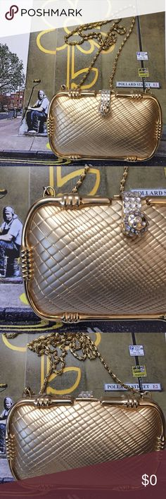 "SASHA 70'S Vintage Gold Metal Small Evening bag Gorgeous Sasha Gold Metal Evening bag. 40""gold chain with a 20"" drop, 6"" wide, 4.6"" high, 2.5 deep. Black lining with rhinestone magnet closure ( closure missing 1 small front rhinestone and 2 on the sides ). Wonderful condition SASHA Bags Clutches & Wristlets"