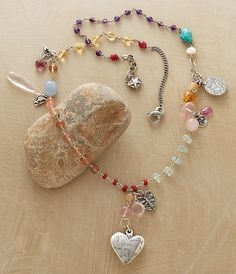 gemstories:  Beautiful Love Necklace Your beautiful love is in my soul. Another Jes MaHarry favorite. Sigh. Moonstone, turquoise, sunstone, quartz, tourmaline, citrine, amethyst, whitehearts, and sterling silver charms representing good luck, growth, courage, and integrity.