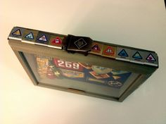 This is a shadow box that I made for my son when he crossed over from Cub Scouts to Boy Scouts. It shows his time while in Cub Scouts. It is only a 8.5 x 10 shadow box so I put the most important items and glued most of his belt loops and belt to the outside.