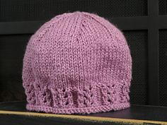 Ravelry: Lacie Gracie - Lace Ribbed Hat pattern by Claudia Szitar   Worsted yarn