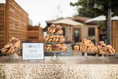 Sogno del fiore wedding reception in Santa Ynez modern donut dessert table with gold sequin table cloth