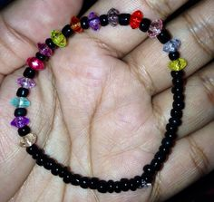 Black Beads with Multi-Colored Centered Beads Bracelet #diy #crafts #hobby